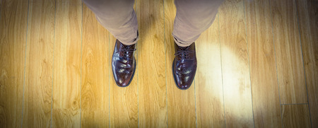 dress shoes: Overhead of mans dress shoes on wooden floor