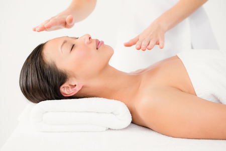 alternative therapy: Young woman receiving alternative therapy at health spa Stock Photo