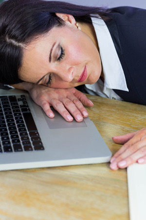 taking nap: Businesswoman taking a nap on her desk in her office