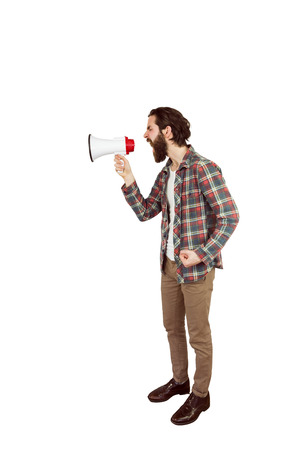 outraged: Handsome hipster shouting through megaphone on white background