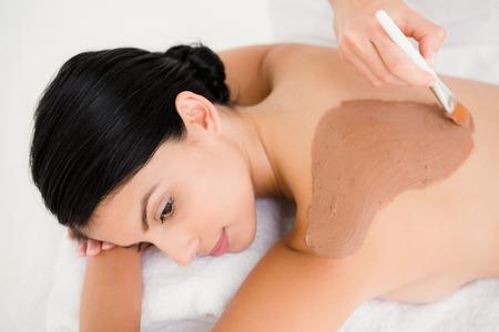 beauty treatment: Beautiful brunette enjoying a chocolate beauty treatment at the health spa
