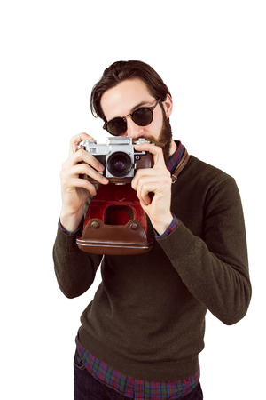 take time out: Hipster using his vintage camera on white background