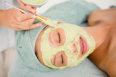 woman towel: Close-up of an attractive young woman receiving treatment at spa center Stock Photo