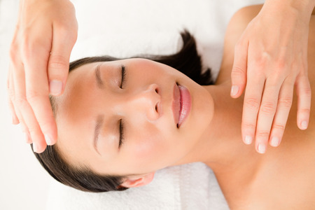 alternative therapy: Close up view of a young woman receiving alternative therapy at health spa Stock Photo