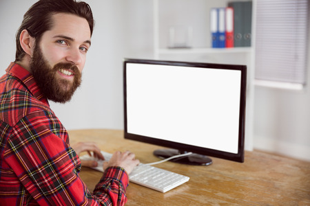 businessman working at his computer: Hipster businessman working on his computer in his office Stock Photo