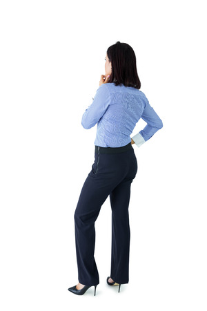 Businesswoman standing and thinking on white background Stock Photo