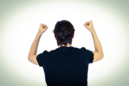 banging: Handsome hipster beating his fists on vignette background Stock Photo