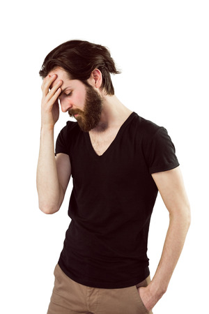 bowed head: Handsome hipster with head in hand on white background