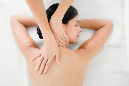 Upward view of woman receiving back massage at spa center Stock Photo