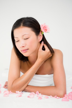 massage  table: Relaxed woman on the massage table at the health spa Stock Photo