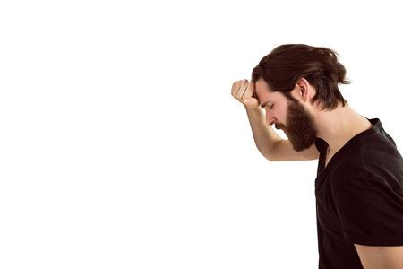desolaci�n: Handsome hipster feeling depressed on white background