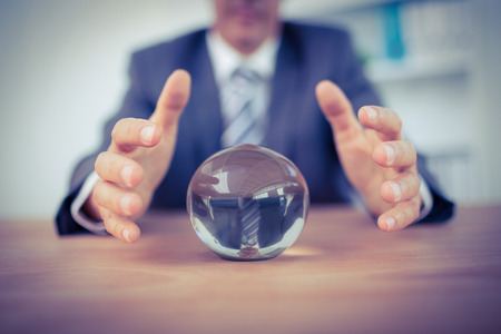 Businessman forecasting a crystal ball in the office 版權商用圖片 - 44768749