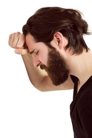 bleakness: Handsome hipster feeling depressed on white background