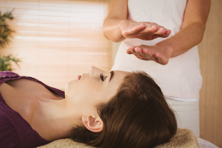 therapy room: Young woman having a reiki treatment in therapy room