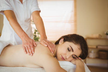 therapy room: Young woman getting a massage in therapy room Stock Photo