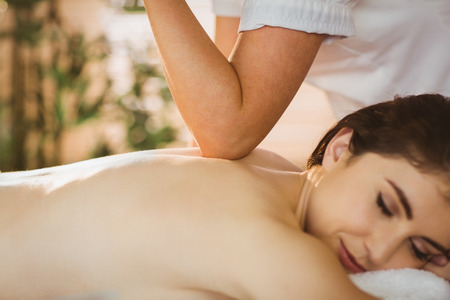 relax massage: Young woman getting a massage in therapy room Stock Photo