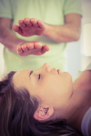 reiki: Relaxed pregnant woman getting reiki treatment in a studio Stock Photo