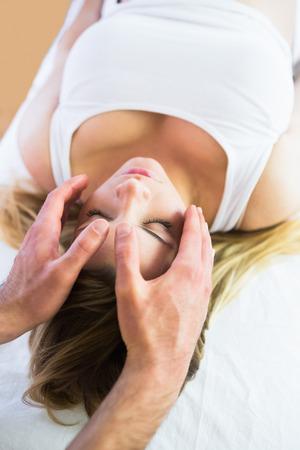 reiki: Relaxed pregnant woman enjoying reiki technique in a studio Stock Photo