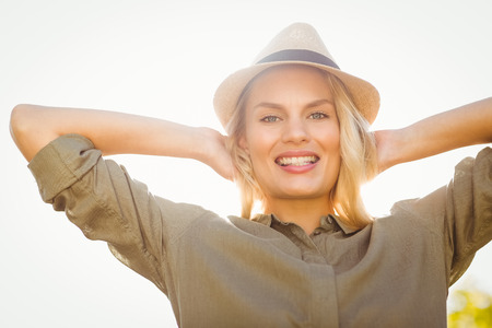 arms behind head: Portrait of a smiling blonde with arms behind the head Stock Photo