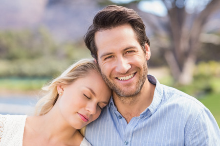 eye closed: Portrait of a smiling couple on date relaxing with eye closed Stock Photo