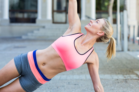 woman bra: Pretty woman planking on the floor on a sunny day