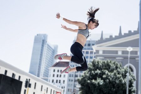 sunny: Woman doing parkour in the city on a sunny day