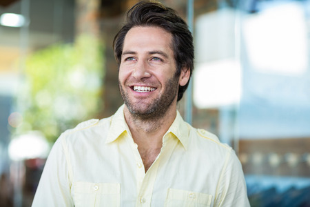Smiling attractive man at shopping mall