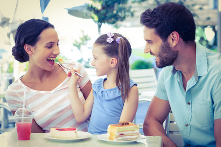 A family eating at the restaurant on a sunny day