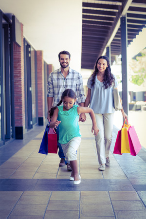 adult family: Happy family with shopping bags at the mall