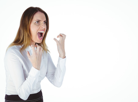 Angry yelling businesswoman against a white background