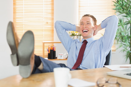 feet up: Relaxed businessman with his feet up in his office