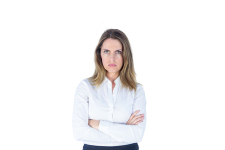 tied hair: Businesswoman looking sad with her arms crossed against a white background