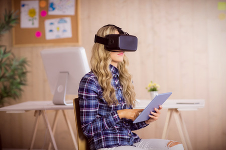 pretty lady: Pretty casual worker using oculus rift in her office
