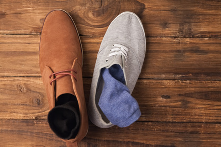 dressy: Casual and dressy mens shoes on wooden table