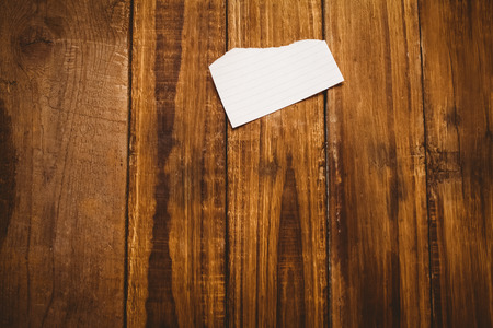 table scraps: Scrap of paper on wooden table with copy space