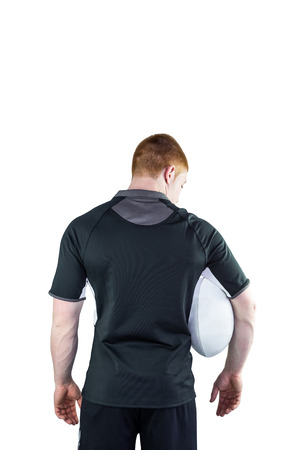 rugby ball: Back view of a rugby player holding a rugby ball