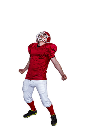 triumph: A triumph of an american football player with black background Stock Photo