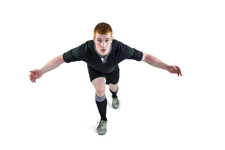 opponent: Portrait of a rugby player tackling the opponent