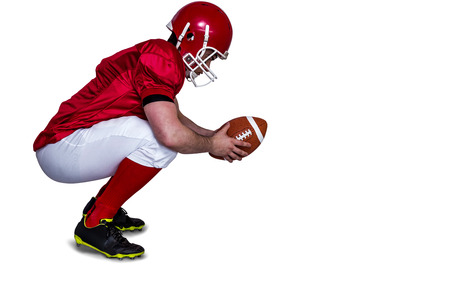 profile view: Profile view of an american football player in attack stance
