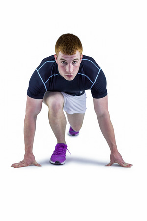 Portrait of a muscular rugby player in running stance Stock Photo