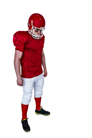 unsmiling: Unsmiling american football player on a white background