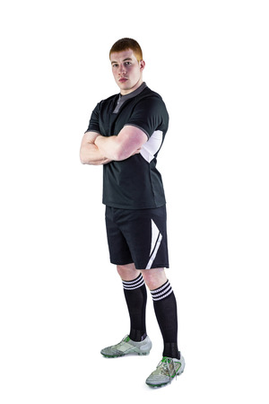 profile view: Profile view of a serious rugby player with arms crossed