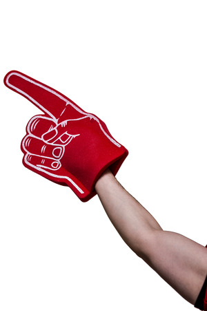 foam hand: Close up view of an american football player holding supporter foam hand Stock Photo