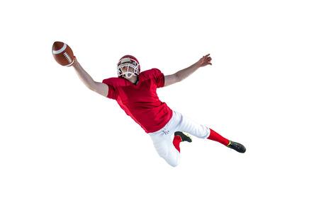 jugador de futbol: Jugador de f�tbol americano de anotar un touchdown en un fondo blanco