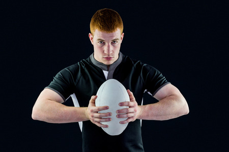 rugby: Portrait of a rugby player holding a rugby ball Stock Photo