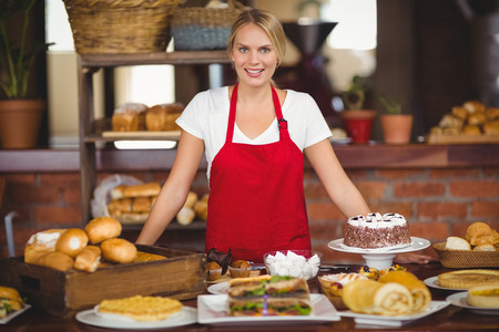 bended: Portrait of a waitress bended over a food table at the coffee shop Stock Photo