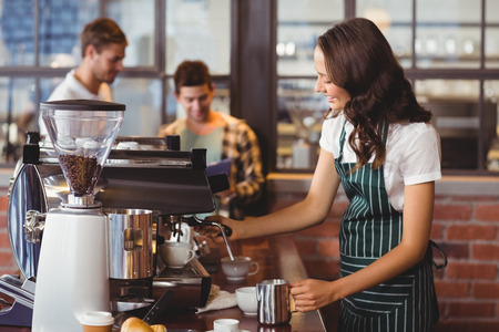 man coffee: Pretty barista making a cup of coffee at the coffee shop Stock Photo
