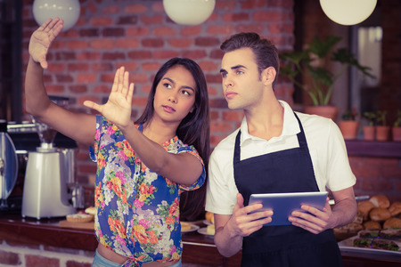 barista: Pretty customer explaining to waiter at coffee shop