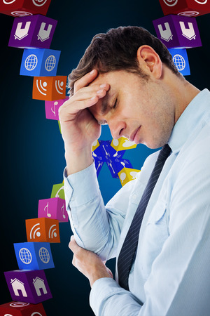pounding head: Businessman with a headache against blue background with vignette Stock Photo
