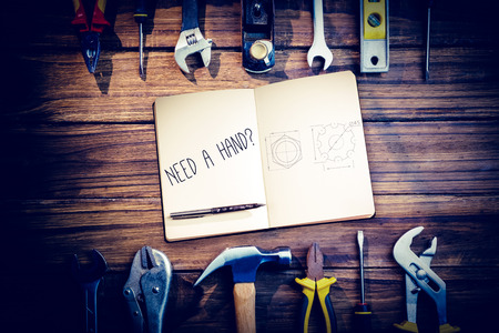 in need of space: The word need a hand? and notebook and pen against blueprint Stock Photo